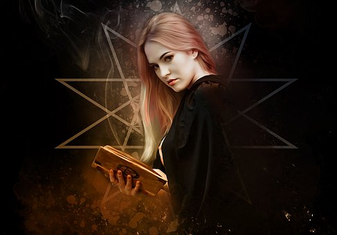 本を持った魔法使いの女性