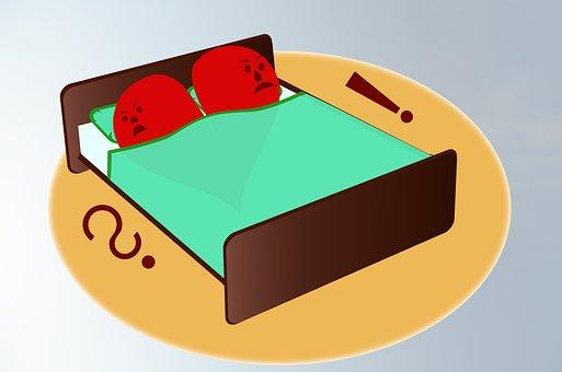 ベッドで険悪な夫婦