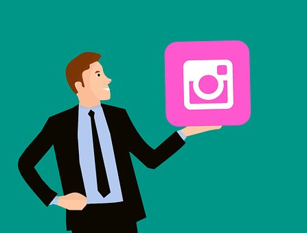 Instagramのロゴを持つ男性