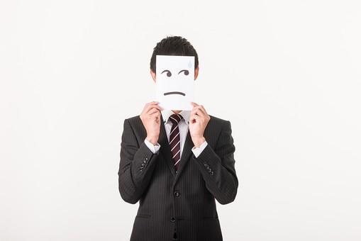 顔を隠すサラリーマン男性
