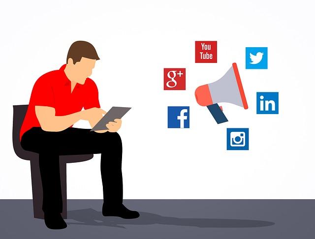 ソーシャルメディアのアイコンと男性